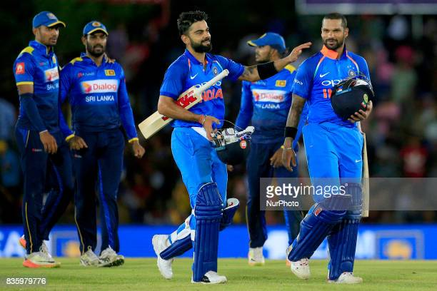 Indian cricketers Virat Kohli and Shikhar Dhawan walk back to the pavilion after securing a 9 wicket victory during the 1st One Day International...