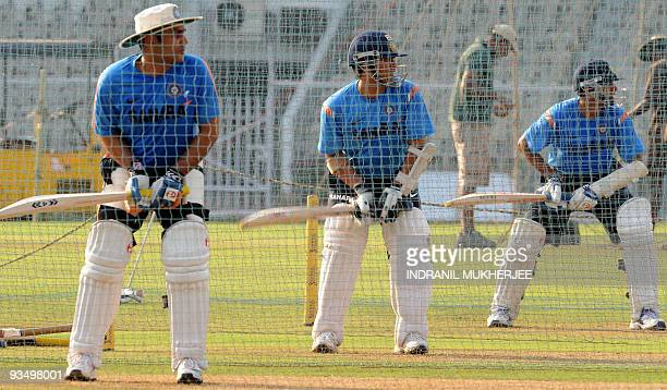Indian cricketers Virender Sehwag Sachin Tendulkar and Rahul Dravid bat in the nets during a training session ahead of the third and final cricket...