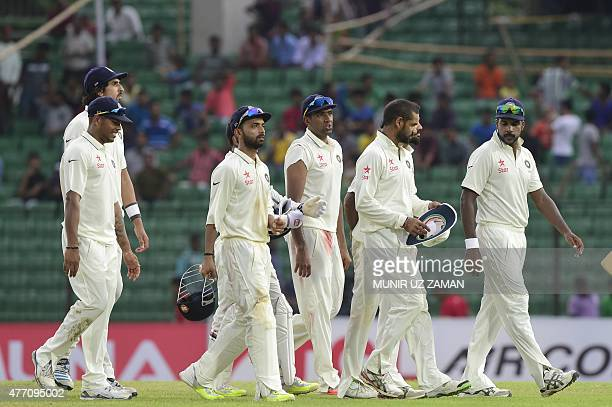Indian cricketers walk off the field after the final day of the Test match between Bangladesh and India at Khan Shaheb Osman Ali Stadium in...