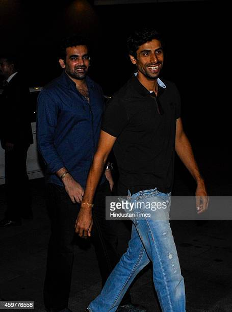 Indian cricketers Zaheer Khan and Ashish Nehra arrive for the felicitation ceremony of cricketer Rohit Sharma who hit a worldrecord double century on...