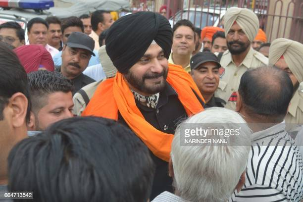 Indian cricketerturnedpolitician and Punjab Cabinet Minister Navjot Singh Sidhu meets constituents during a visit to the Ram Bagh Garden in Amritsar...