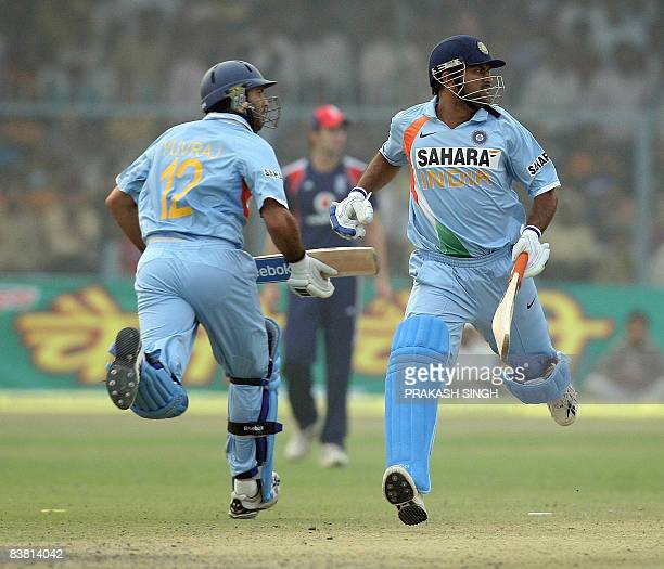 Indian cricketerx Yuvraj Singh and Mahendra Singh Dhoni run between the wickets during the third One Day International match between India and...