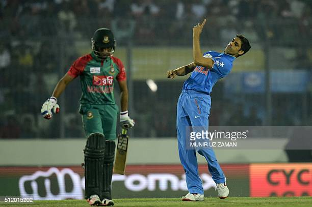 Indian crikceter Ashish Nehra reacts after the dismissal of Bangladesh batsman Mohammad Mithun during a Twenty20 cricket match between India and...