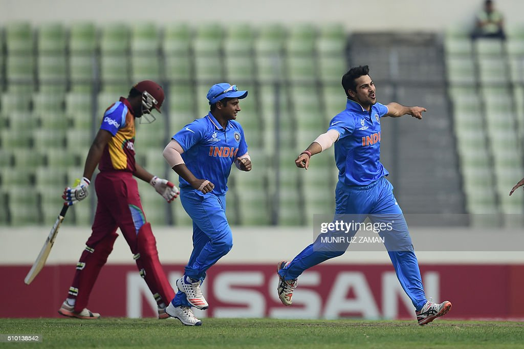 Indian crikceter Mayank Dagar (R) reacts after the dismissal of the West Indies cricketer Jyd Goolie (L) during the under-19s World Cup cricket final between India and West Indies at the Sher-e-Bangla National Cricket Stadium in Dhaka on February 14, 2016. AFP PHOTO/Munir uz ZAMAN / AFP / MUNIR UZ ZAMAN