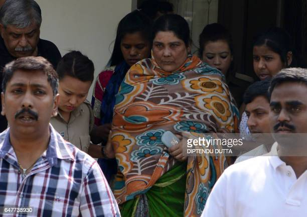 Indian Crime Investigation Department officials escort Chandana Chakraborty from CID office in Siliguri on March 4 towards an appearance at a court...