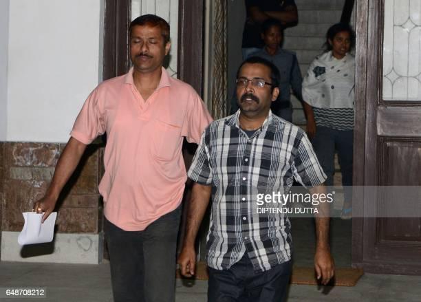 Indian Crime Investigation Department officials escort Child Welfare Officer Debashis Chandra is escorted from a Indian Crime Investigation...
