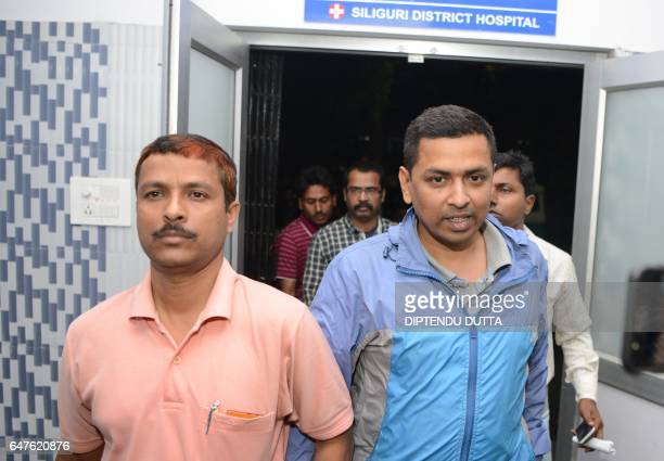 Indian Crime Investigation Department officials escort District Child Protection Officer of Darjeeling district Mrinal Ghosh from a police station in...