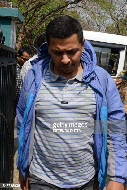 Indian Crime Investigation Department officials escort District Child Protection Officer of Darjeeling district Mrinal Ghosh from CID office in...