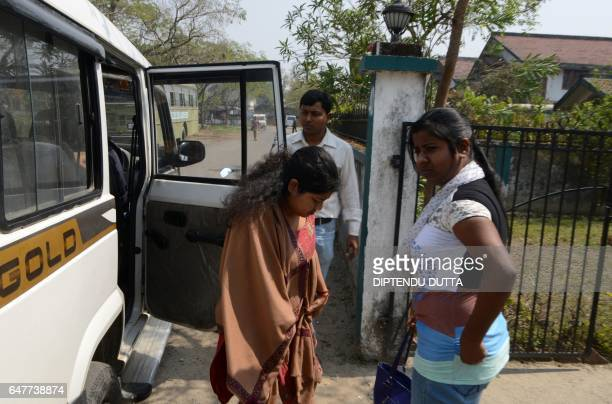 Indian Crime Investigation Department officials escort Sonali Mandal from CID office in Siliguri on March 4 towards an appearance at a court in...