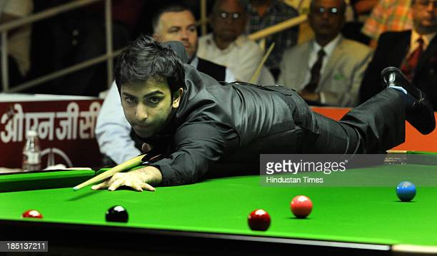 Indian cueist Pankaj Advani in action against Stuart Bingham at World Ranking Snooker Indian Open 2013 on October 17 2013 in New Delhi India India's...