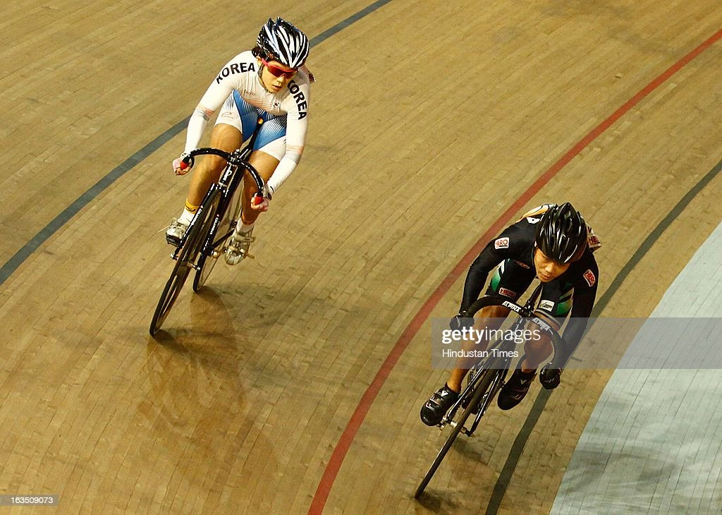 Indian cyclist Deborah (Silver Medalist) with Korea's Yeonhee Jang (Gold Medalist) in the 'women's junior sprint' during finals of at the Asian Cycling Championship at IG Cycling Velodrome on March 11, 2013 in New Delhi, India.
