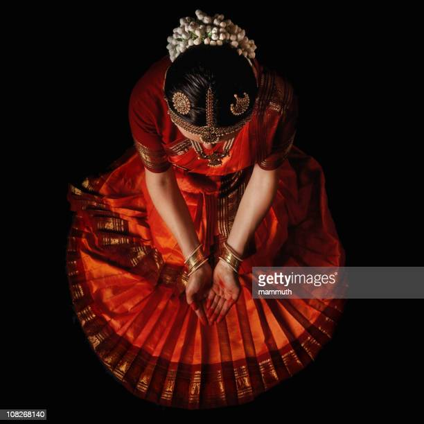 Indian dancer praying before the holy dance