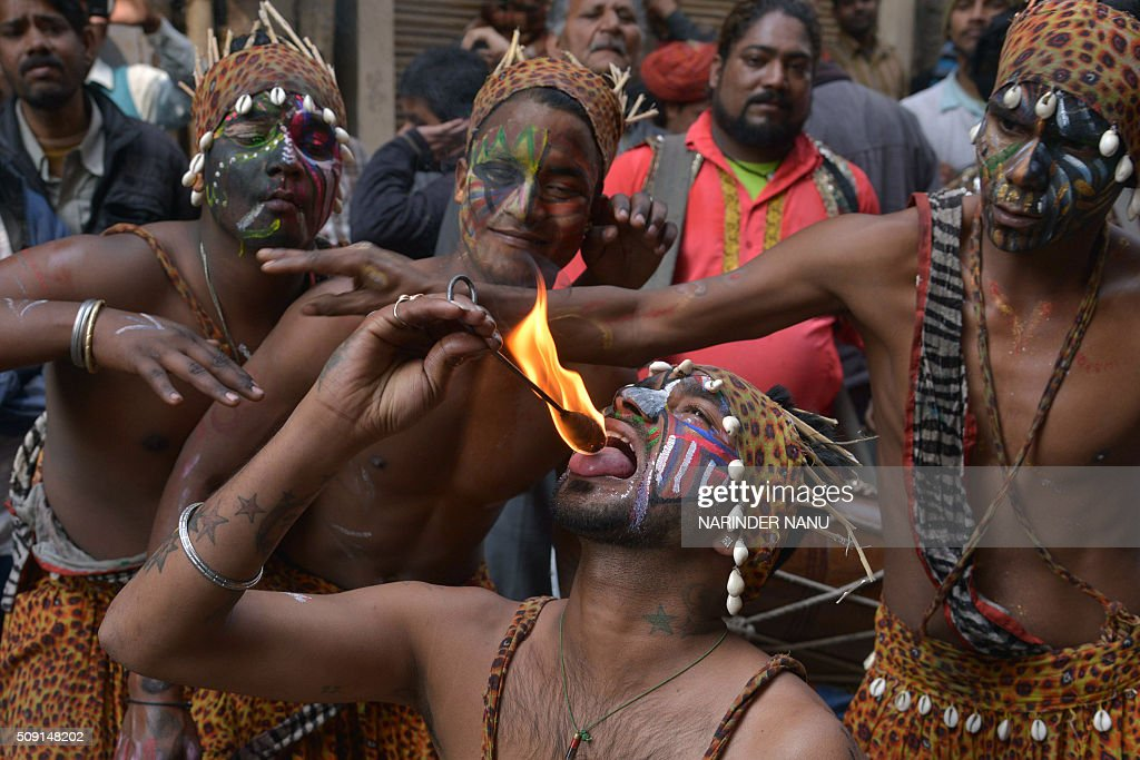Indian dancers perform a fire breathing act during a procession to mark the 661st anniversary of the birth of Hindu guru Bawa Lal Dayal Maharaj in Amritsar on February 9, 2016. Bawa Lal Dayal Maharaj, a popular leader of his time, is especially revered by devotees of a temple in the town of Dhyanpur, some 45 kms north of Amritsar. AFP PHOTO/NARINDER NANU / AFP / NARINDER NANU