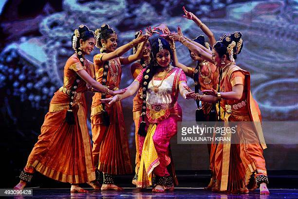 Indian dancers perform 'Bharatanatyam' a traditional dance form from the state of Tamil Nadu during 'CilappatikaramTale of an Anklet' dance opera in...