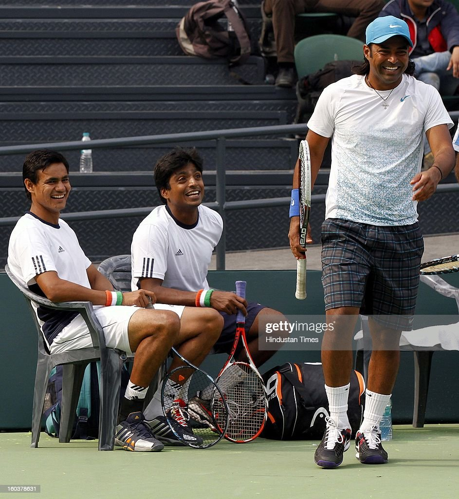 Indian Davis Cup player Vijayant Malik (L), Ranjeeth (C) and Leander Paes shares some light moments during the practice session at DLTA on January 30, 2013 in New Delhi, India. After the rebellion by top Indian tennis players AITA has fielded an inexperienced team for the Davis Cup tie against South Korea that will begin on February 1.