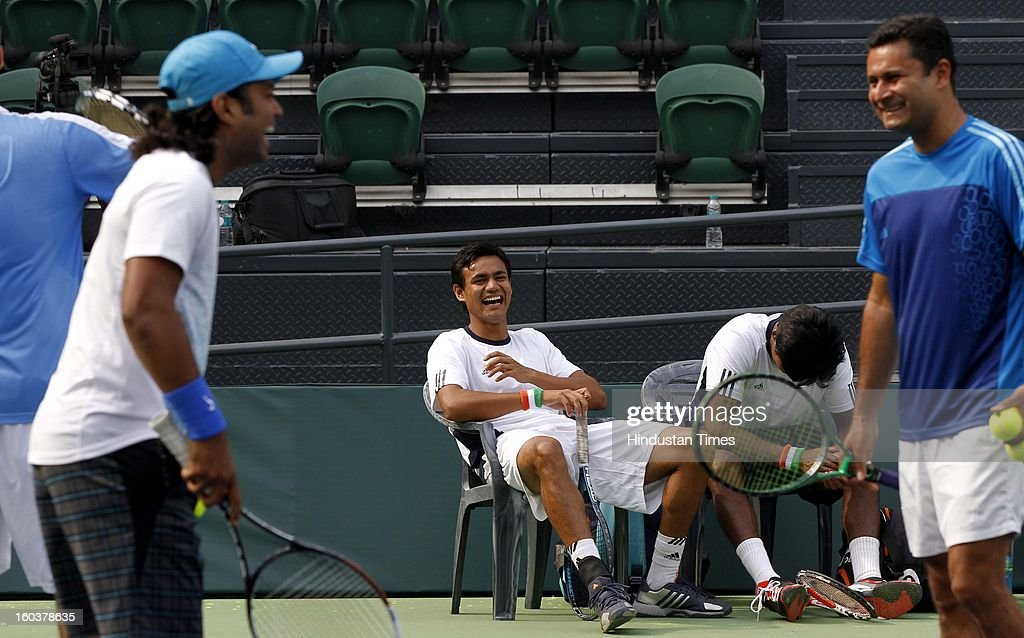 Indian Davis Cup player Vijayant Malik shares some light moments with Leander Paes during the practice session at DLTA on January 30, 2013 in New Delhi, India. After the rebellion by top Indian tennis players AITA has fielded an inexperienced team for the Davis Cup tie against South Korea that will begin on February 1.