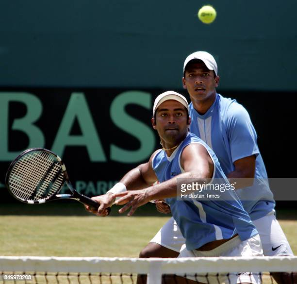 Indian Davis cup players Mahesh Bhupathi and Leander Paes taking a shot during their doubles match against Pakistan at Brabourne Stadium on Saturday