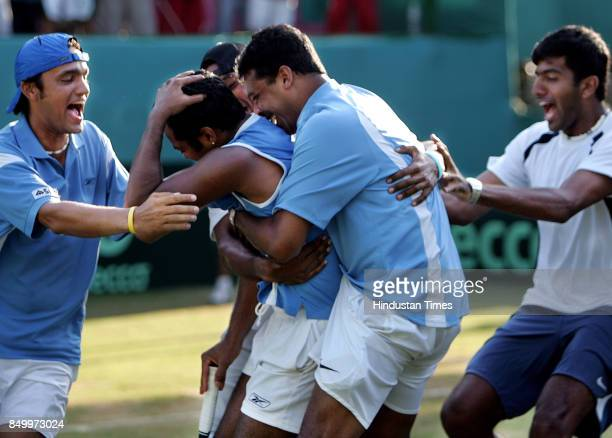 Indian Davis Cup team hugs Leander Paes after his win over Aqeel Khan in the 5th singles match of the Asia Oceana Group 1 playoff tie at the...