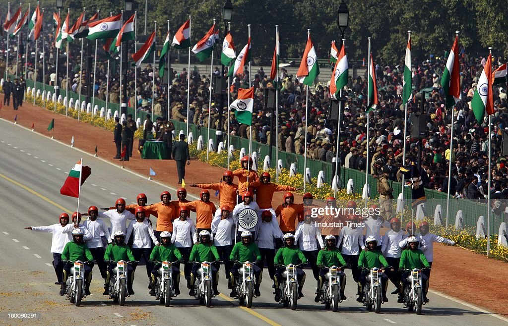 Indian defense force personnel perform stunts on motorcycles during the 64th Republic Day parade celebration at Raj path on January 26, 2013 in New Delhi, India. India marked its Republic Day with celebrations held under heavy security, especially in New Delhi where large areas were sealed off for an annual parade of military hardware.