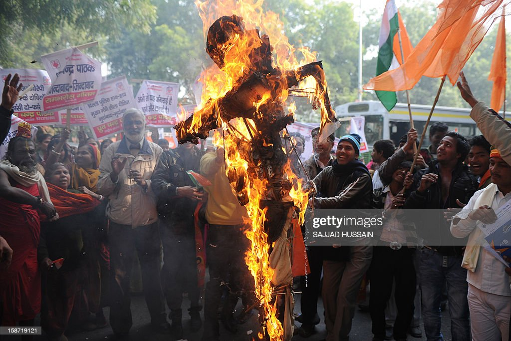 Indian demonstrators burn an effigy representing rapists during a protest calling for better safety for women following the rape of a student in the Indian capital, in New Delhi on December 26, 2012. Protests across India over the last week against sex crimes have denounced the police and government, with the largest in New Delhi at the weekend prompting officers to cordon off areas around government buildings. One policeman was killed and more than 100 people injured in the violence. AFP PHOTO/SAJJAD HUSSAIN