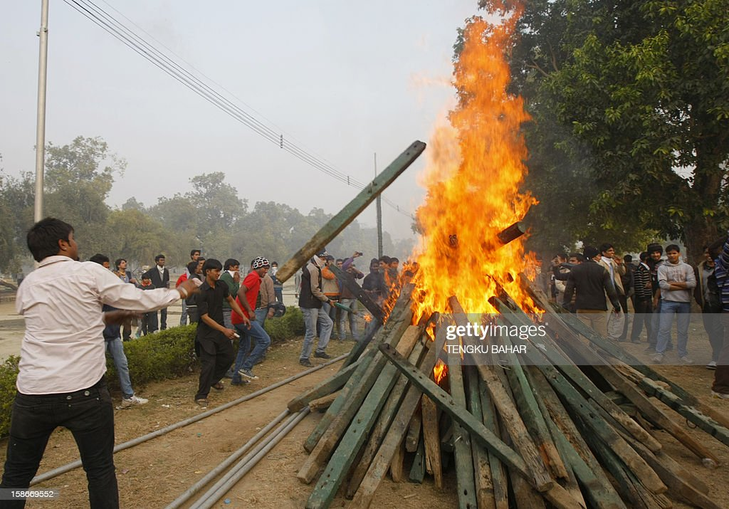 Indian demonstrators burn wooden poles that were torn down from barricades during a protest calling for better safety for women following the rape of a student last week, in front the India Gate monument in New Delhi on December 23, 2012. In the biggest protest so far, several thousand college students rallied at the India Gate monument in the heart of the capital where they were baton-charged, water cannoned and tear gassed by the police.