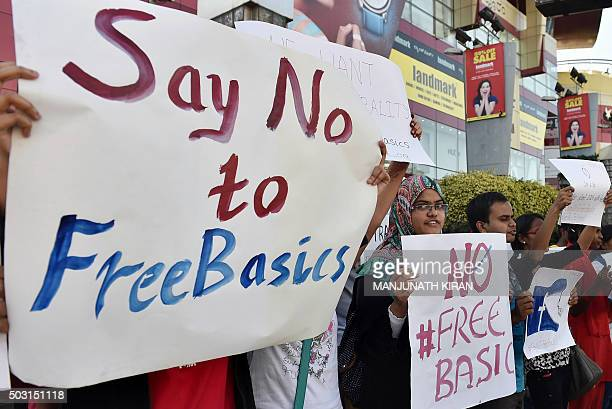 Indian demonstrators of Free Software Movement Karnataka hold placards during a protest against Facebook's Free Basics initiative in Bangalore on...