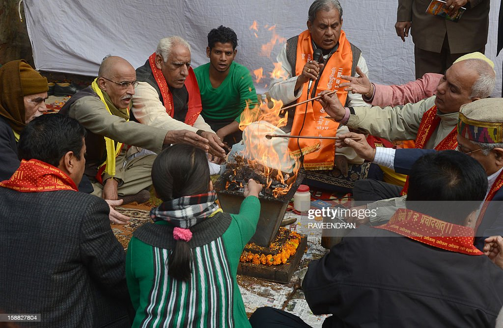 Indian demonstrators perform a prayer ritual in memory of a gang rape victim in New Delhi on December 31, 2012. The family of an Indian gang-rape victim said they would not rest until her killers are hanged as they spoke of their own pain and trauma over a crime that has united the country in grief.