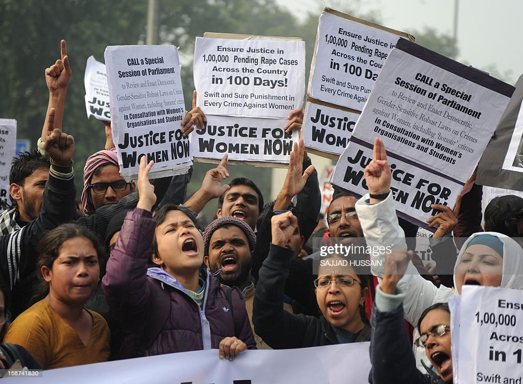 Indian demonstrators shout slogans and wave placards as they move towards India Gate in New Delhi on December 27, 2012, during a protest calling for better safety for women following the rape of a student in the Indian capital. Protests across India over the last week against sex crimes have denounced the police and government, with the largest in New Delhi at the weekend prompting officers to cordon off areas around government buildings. One policeman was killed and more than 100 people injured in the violence.