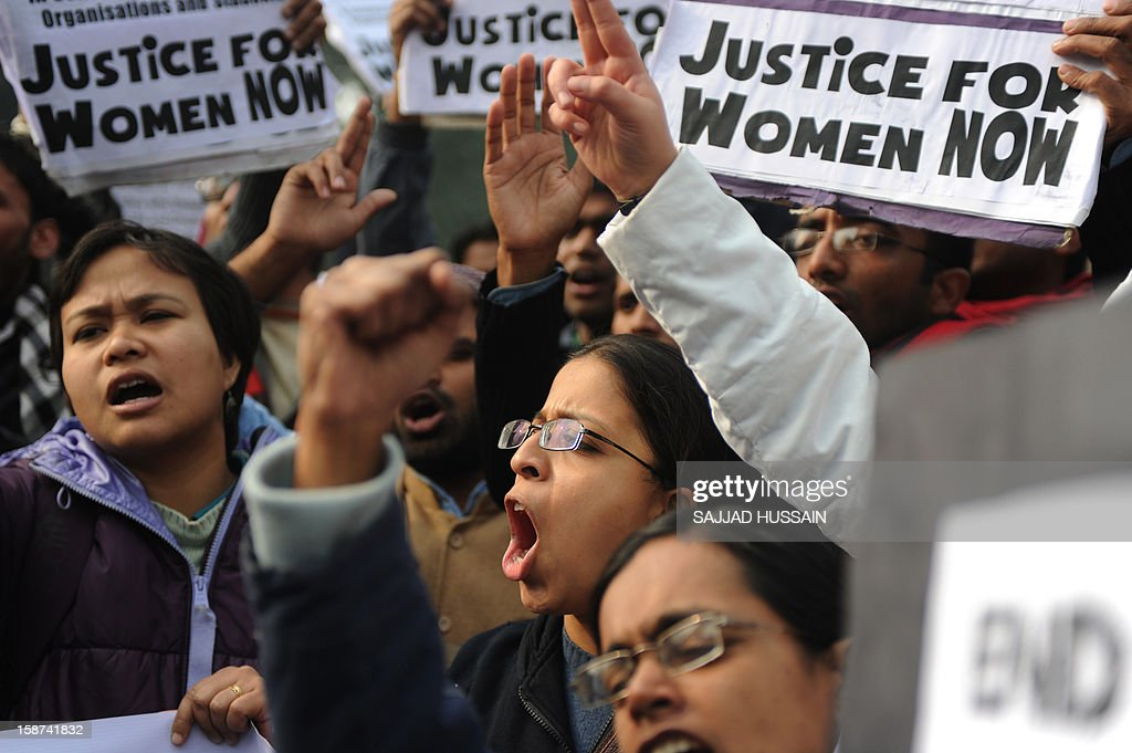 Indian demonstrators shout slogans and wave placards as they move towards India Gate in New Delhi on December 27, 2012, during a protest calling for better safety for women following the rape of a student in the Indian capital. Protests across India over the last week against sex crimes have denounced the police and government, with the largest in New Delhi at the weekend prompting officers to cordon off areas around government buildings. One policeman was killed and more than 100 people injured in the violence. AFP PHOTO/SAJJAD HUSSAIN