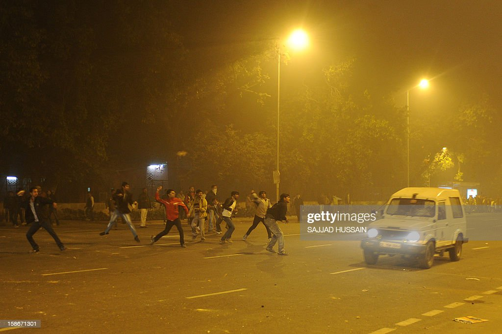 Indian demonstrators stone an escaping police vehicle as night falls during a protest calling for better safety for women following the rape of a student last week, in front the India Gate monument in New Delhi on December 23, 2012. In the biggest protest so far, several thousand college students rallied at the India Gate monument in the heart of the capital where they were baton-charged, water cannoned and tear gassed by the police.