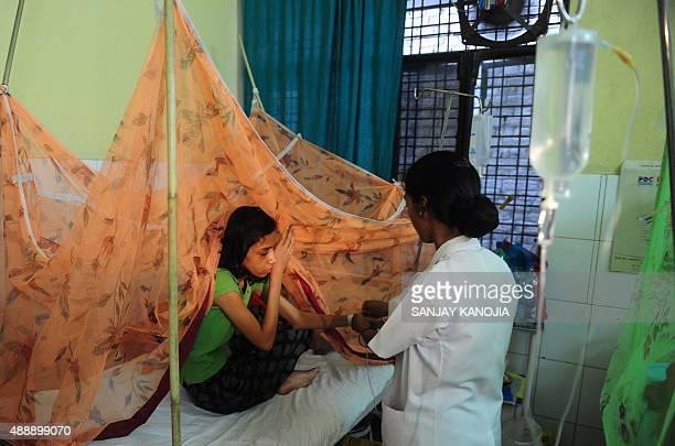 Indian dengue patient Ritika Srivastava receives treatment in the dengue ward of a government hospital in Allahabad on September 18 2015 Dengue fever...
