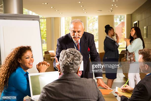 Indian descent, male manager conducts business presentation.