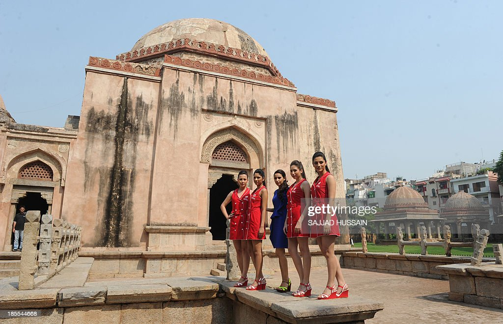 Indian designer Mendira Wirk (C) poses with models sporting Formula One paddock outfits during a promotional event at Hauz Khas village in New Delhi on October 22, 2013. The 2013 Formula One Grand Prix takes place in Greater Noida on the outskirts of New Delhi on October 27.