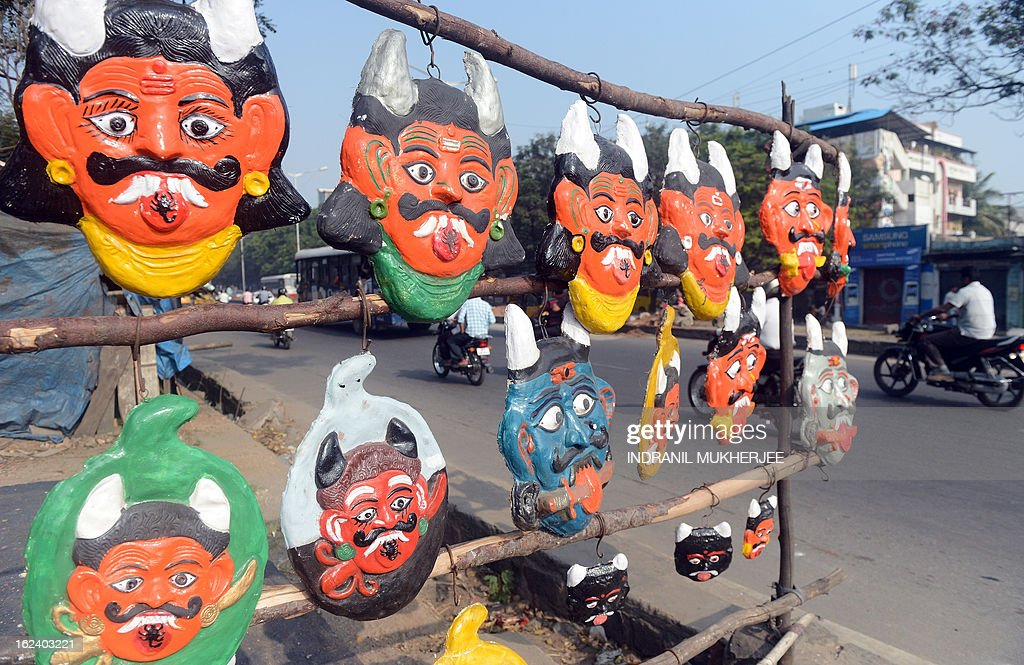 Indian devil masks, believed to ward off evil if hung outside homes, are sold at a roadside stall in Hyderabad on February 23, 2013. India's government was accused Friday of major intelligence failures after twin bicycle bombings killed 16 people, as it emerged police were warned months ago of a possible attack at the site. The near-simultaneous attacks Thursday night outside a cinema and a bus stand in Hyderabad's Dilsukh Nagar district were the first deadly bombings in India since 2011 and triggered international condemnation including from rival Pakistan. AFP PHOTO/Indranil MUKHERJEE