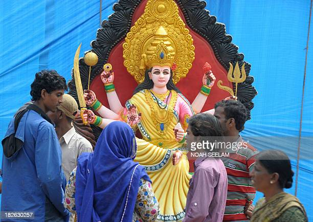 Indian devotees bargain to buy an idol of the Hindu goddess Durga ahead of the DushheraVijaya Dashami festival at outside of a workshop in Hyderabad...