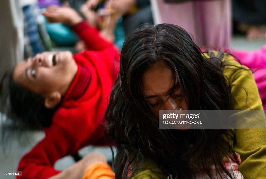 Indian devotees believed to be possessed by evil spirits goes into a state of trance at the Hazrat Shahdana Wali Dargah in Bareilly around 300kms...