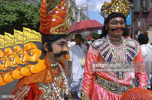 Indian devotees dressed as Ravana from the Indian epic Ramayana and Bhim from the Indian epic Mahabharat take part in the Rath Yatra Festival in...