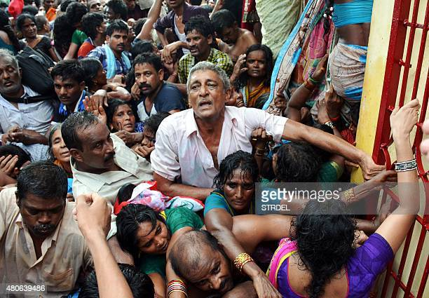 Indian devotees gather after a stampede at a religious festival in Godavari in the Rajahmundry district some 200 kms northeast of Hyderabad on July...