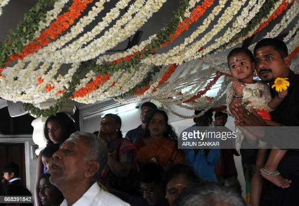 Indian devotees gather at a temple in Chennai on April 14 on the occasion of Vishu or the New Year in accordance with the Malayalam calendar which is...