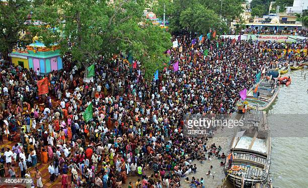 Indian devotees gather on the banks of the Godavari river near the scene of a stampede during a religious festival in Godavari in the Rajahmundry...