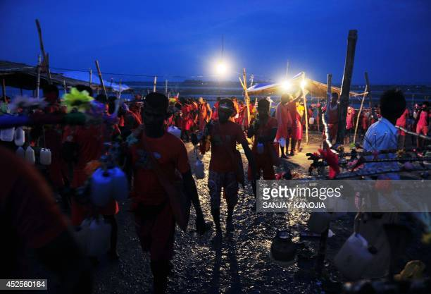Indian devotees of Lord Shiva collect water from the river Ganges to be used as they prepare to walk towards the holy Hindu city of Varanasi during...
