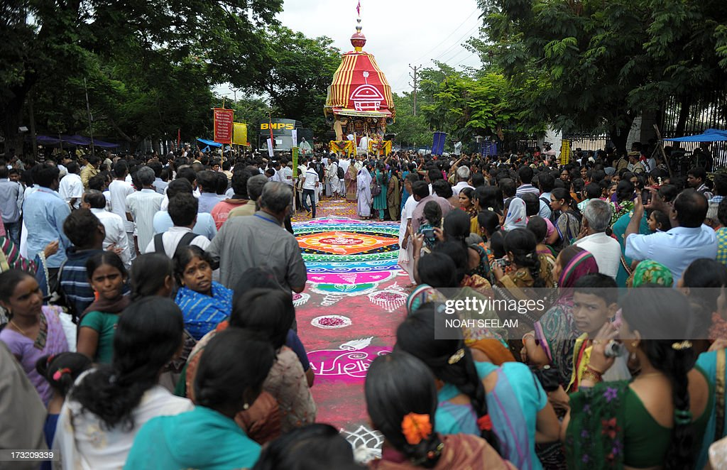 Indian devotees of The International Society of Krishna Conciousness (ISKON) participate in a ritual or 'puja' at the start of the Sri Jagannatha Ratha Yatra in Hyderabad on July 10, 2013. According to mythology, the Ratha Yatra dates back some 5,000 years when Hindu god Krishna, along with his older brother Balaram and sister Subhadra, were pulled on a chariot from Kurukshetra to Vrindavana by Krishna's devotees. AFP PHOTO / Noah SEELAM