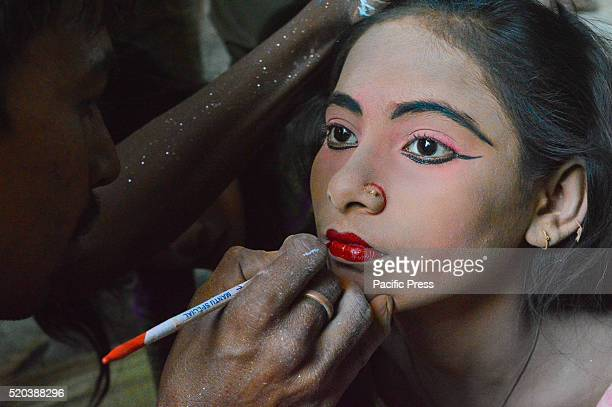Indian devotees painted their face like Lord Krishna at time of Gajan festival