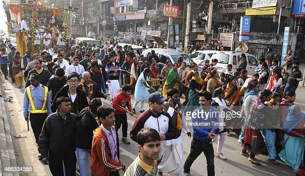 Indian devotees participate during the 14th grand annual Ratha Yatra of Lord Jagannath Balabhadra and Subhadra on February 1 2014 in Gurgaon India...