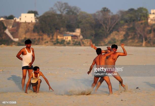 Indian devotees play a game of kabaddi as they warm up before take a holy dip at Sangam the confluence of the rivers Ganges Yamuna and the mythical...