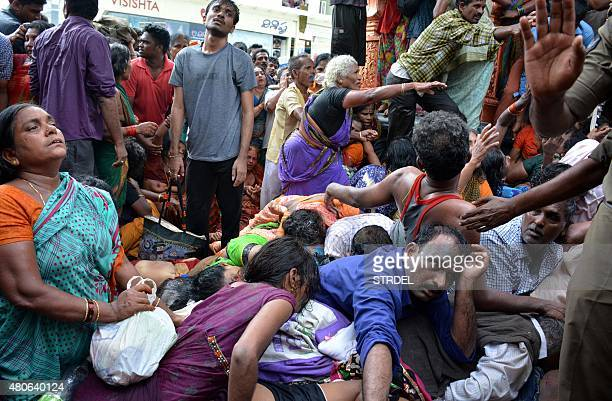 Indian devotees react after a stampede at a religious festival in Godavari in the Rajahmundry district some 200 kms northeast of Hyderabad on July 14...