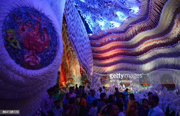 Indian devotees worship Goddess Durga inside the temporary structure called 'pandal' for the celebrations the 'Durga Puja' festival in Siliguri on...