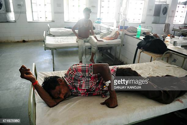 Indian diarrhoea patient Hari Sankar Gupta lies on a bed in a government hospital in Allahabad on May 28 as scorching weather conditions continue...