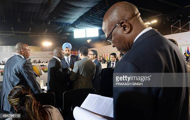 Indian diplomat Navtej Sarna interacts with delegates during the Third IndiaAfrica Forum Summit at the Indira Gandhi stadium in New Delhi on October...