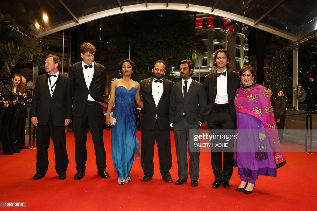 Indian director Amit Kumar (C) arrives on May 18, 2013 with actors Tannishtha Chatterjee (3rdL), Nawazuddin Siddiqui (3rdR) and Vijay Verma (2ndR) for the screening of the film 'Monsoon Shootout' presented Out of Competition at the 66th edition of the Cannes Film Festival in Cannes. Cannes, one of the world's top film festivals, opened on May 15 and will climax on May 26 with awards selected by a jury headed this year by Hollywood legend Steven Spielberg. AFP PHOTO / VALERY HACHE